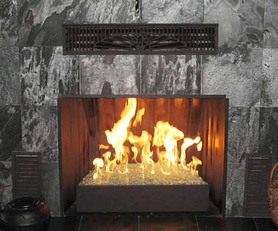modern slate fireplace burning fireglass