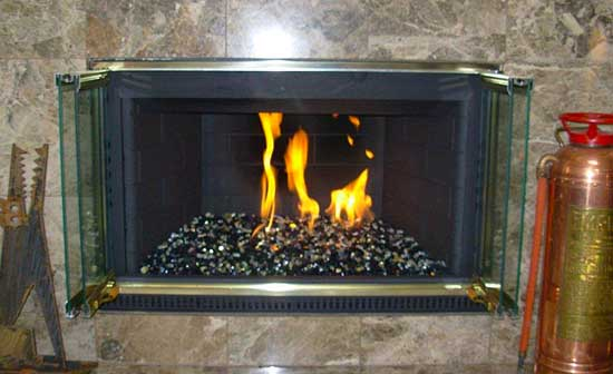 black fireglass burning in a converted gas fireplace
